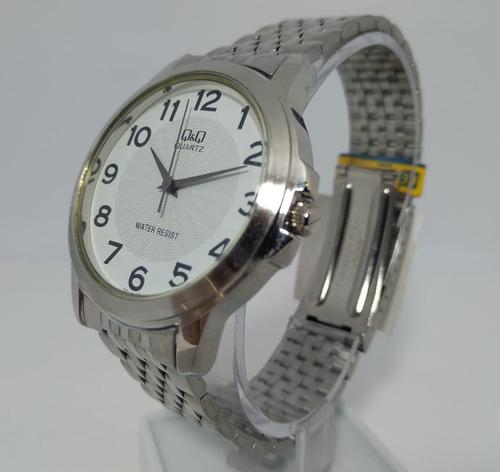 relógio q&q by citizen prata fundo branco q422-204y