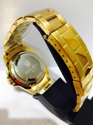 relógio submariner dourado com fundo azul