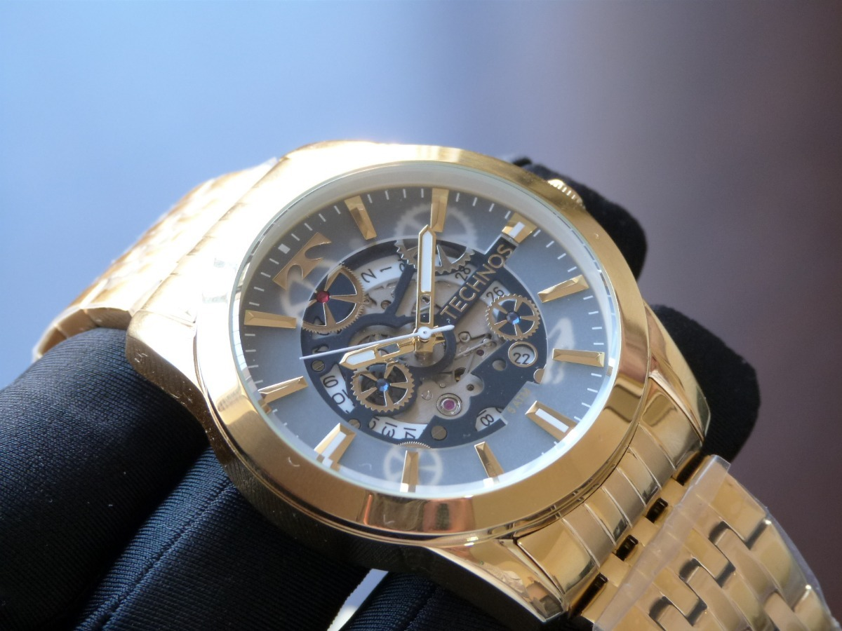 69f16aca680 relógio technos automático dourado 8205nq 4a esqueleto raro. Carregando zoom .