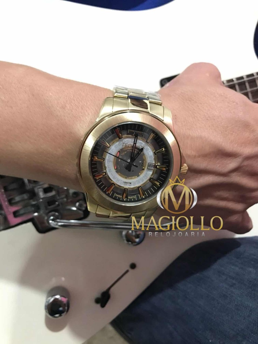 b23a1dcb7c4fc relógio technos essence masculino dourado suiço f06111aa 4w. Carregando  zoom.