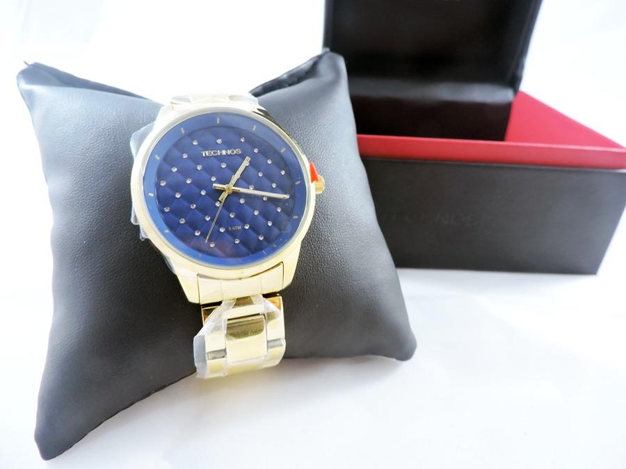 1d8ce13da0bd5 relógio technos feminino dourado c  fundo azul 2035mbw 4a. Carregando zoom.