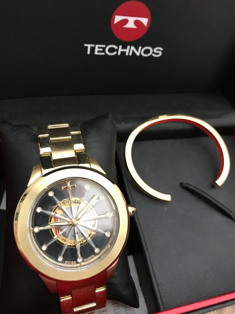 cf5f7eb6c3393 relógio technos feminino dourado kit bracelete f03101aa k4w. Carregando zoom .