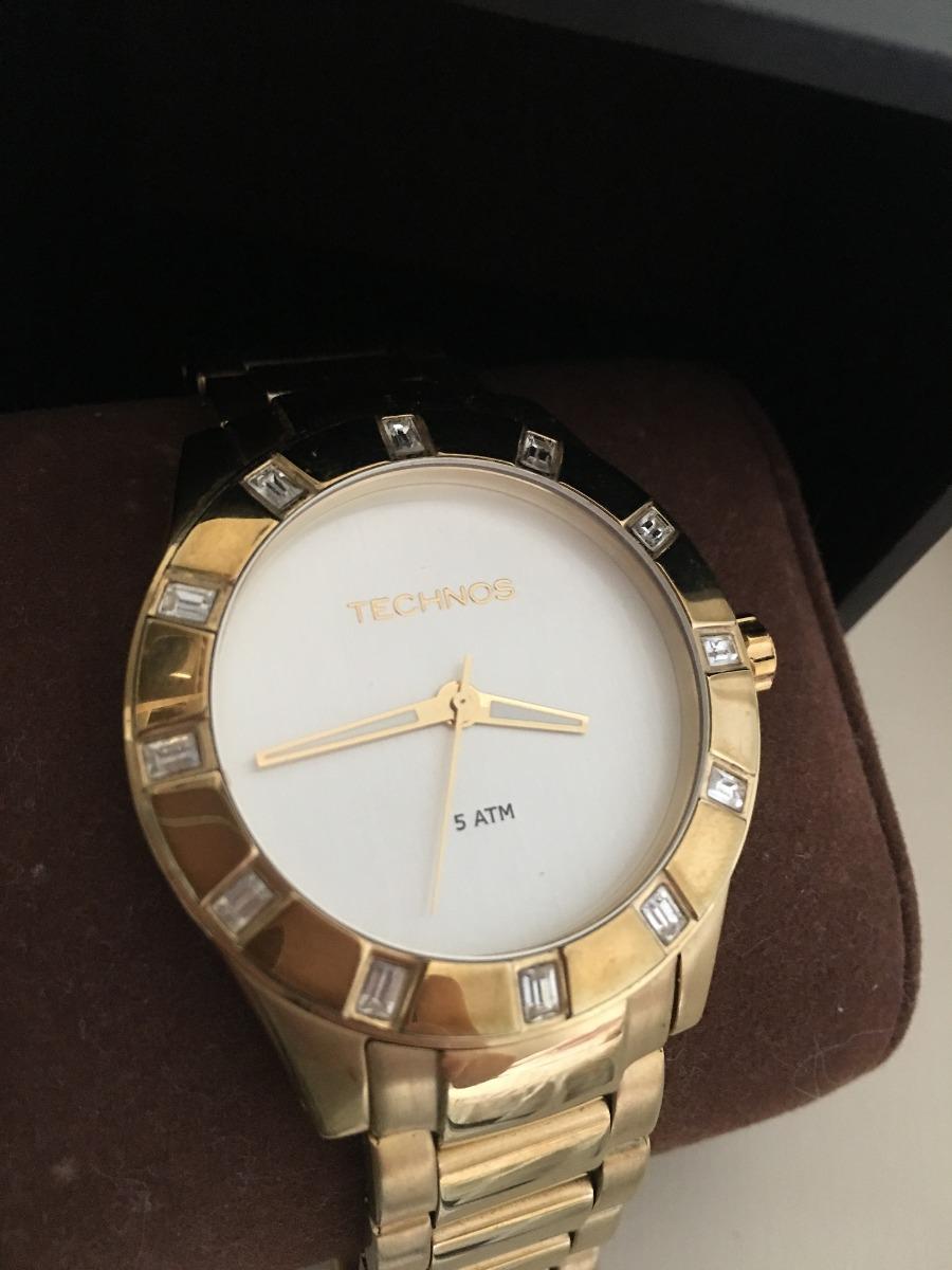 3bf58a0f075 relógio technos feminino elegance crystal swarovski dourado. Carregando  zoom.
