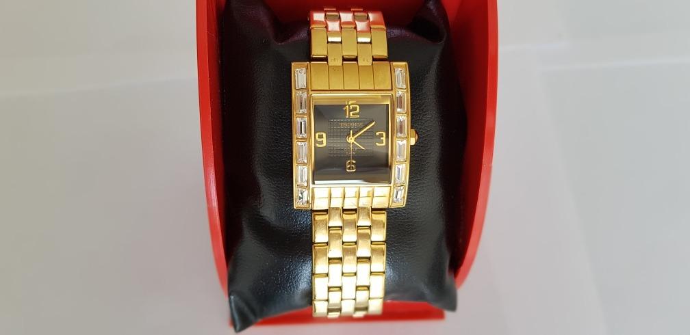 1e57b33a68c relógio technos feminino na caixa novo folheado a ouro lindo. Carregando  zoom.