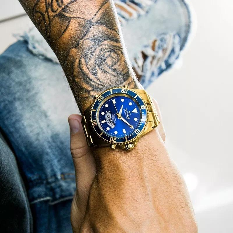 5be13b10bfb85 relógio technos masculino skydiver dourado e azul t205jd 4a. Carregando  zoom.