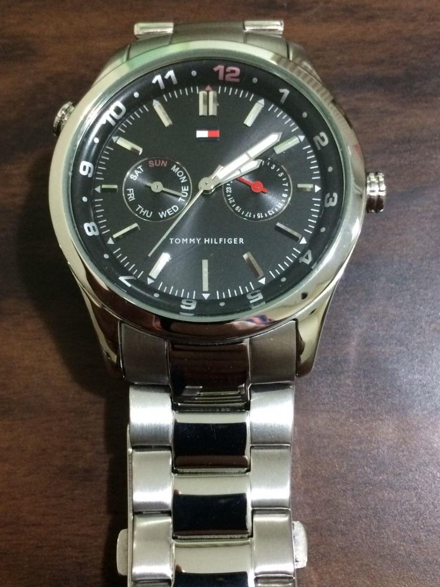 e863089d73c Relógio Tommy Hilfiger Fundo Preto Pulseira Prata - R  240
