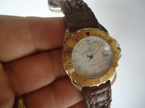 relógiochampion   original semi novo dourado e prata