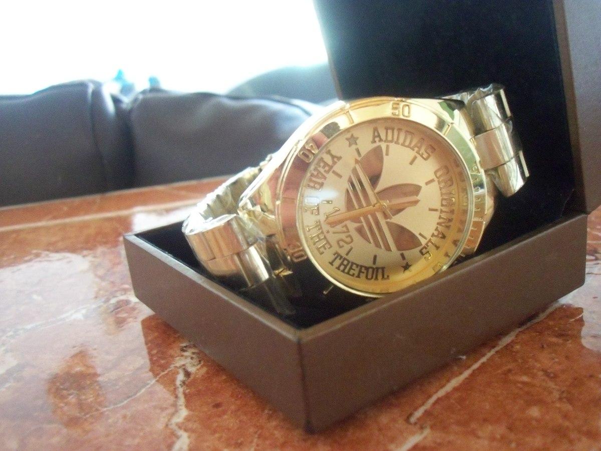 reloj adidas dorado unisex