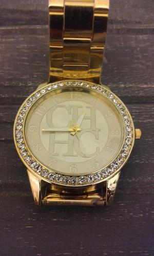 reloj carolina herrera  dorado divino