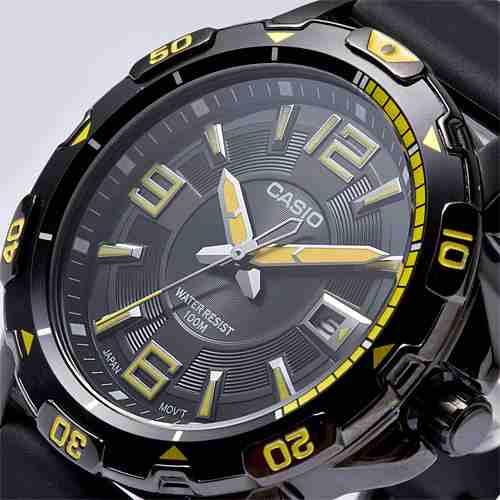 reloj casio model mtd-1065d en amarillo, azul, rojo.