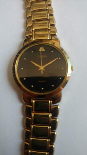 reloj citizen de cuarzo excelente trato