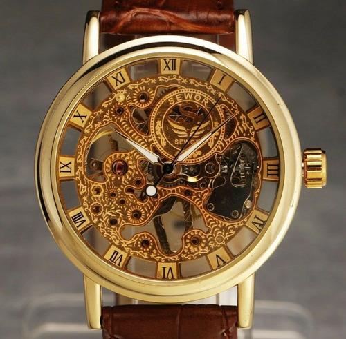 reloj clásico  a cuerda se mueve toda la maquina v.colores