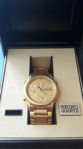 reloj clasico  seiko quartz analogue world time