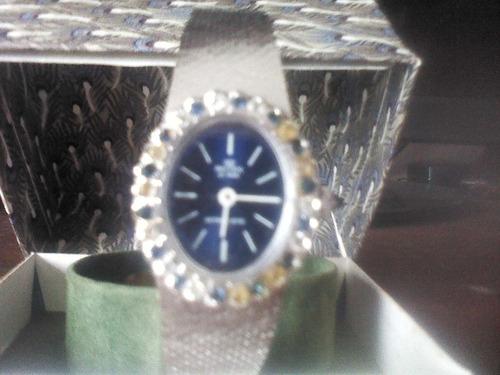 reloj dama de platino con zafiros blancos y azules marca rei