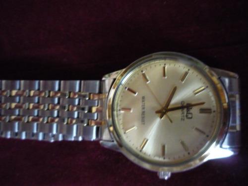 reloj de hombre qyq nuevo de paquete