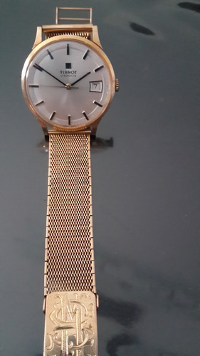 reloj de oro hombre