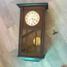 reloj de pared a cuerda con pendulo