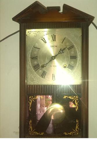 reloj de pared con cuerda y pendulo antiguo,45 años