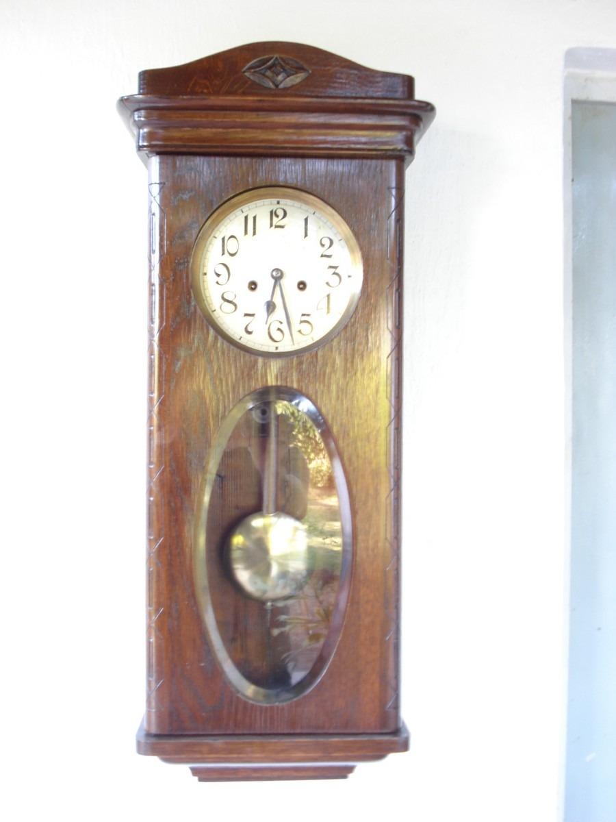 Reloj de pared de roble con pendulo funcionando for Reloj de pared con pendulo