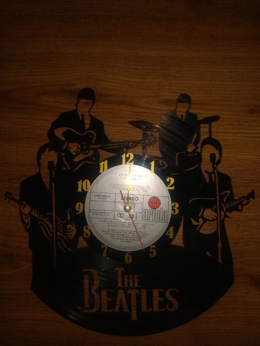 reloj de pared en disco de acetato
