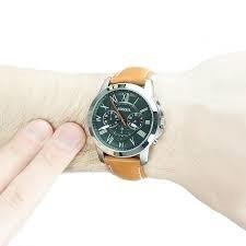 reloj es fossil 100% originales. super oferta en enero $145