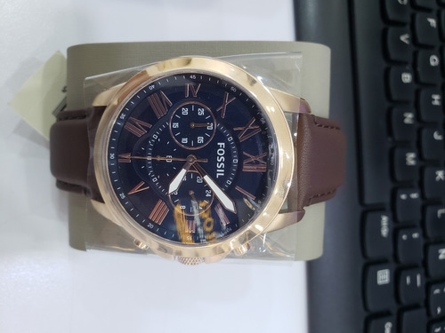 reloj fossil grant dorado, manillas color marron