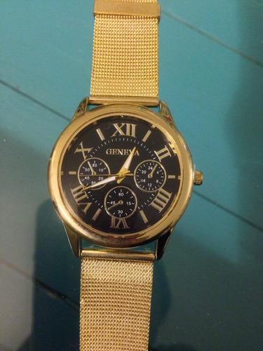 reloj geneva dorado divino