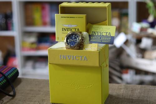 reloj invicta trinite gold