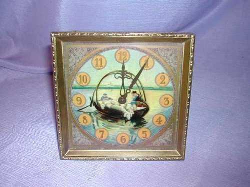 reloj kienzle  en bronce muy antiguo