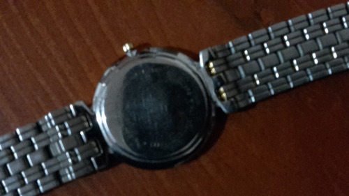 reloj mido números romanos