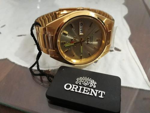 reloj orient dorado