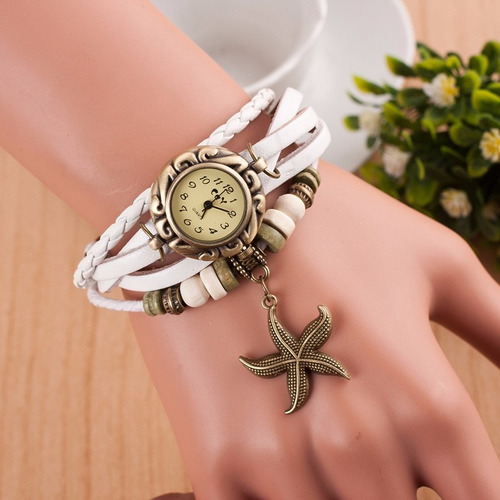 reloj  para dama en cuero colores surtidos y dijes