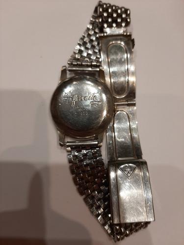 reloj protex , suizo, cuerda manual muy antiguo.