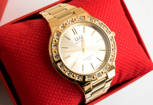 reloj q & q elegante correa de acero dorado para mujer