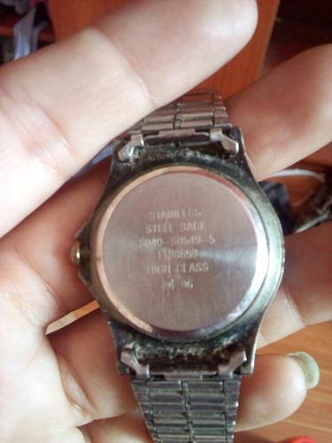 reloj quartz hombre stainless steel. usado. 55 soles