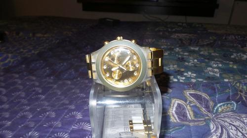 reloj swatch full blooded dorado