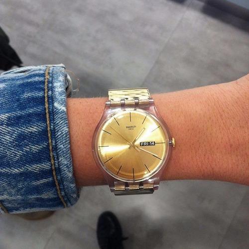 reloj swatch suok702 dazzling light rostfrei suok707