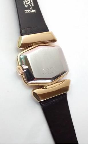 reloj universal geneve chapa oro cuerda video