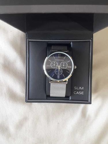 reloj van heusen plateado