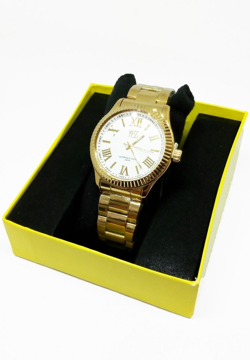 Reloj metalico dorado hombre