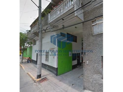 remate bancario edificio con 12 viviendas !!