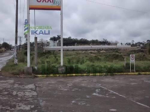 renta terreno comercial tuxpan con una superficie de 1,000 m² rellenado con tierra, en el libramiento lopez mateos, a un costado de la gasolinera oxxi, casi frente al motel monte cristo, en la coloni