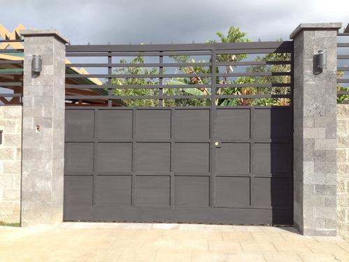 reparaciones de puertas portones en área de herrería