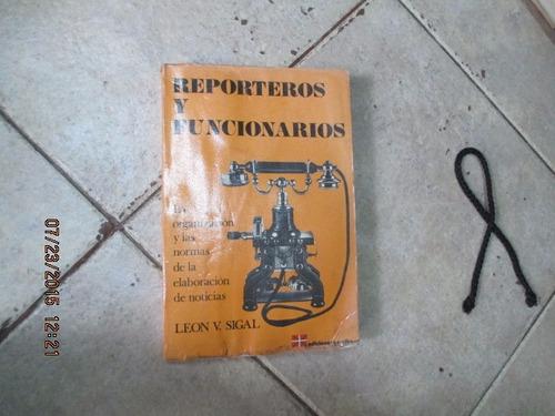 reporteros y funcionarios - león sigal