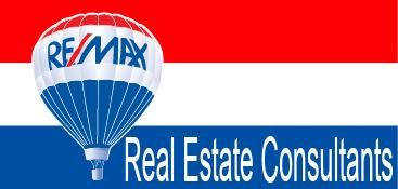 Logo de  Re/max Real Estate Consultants