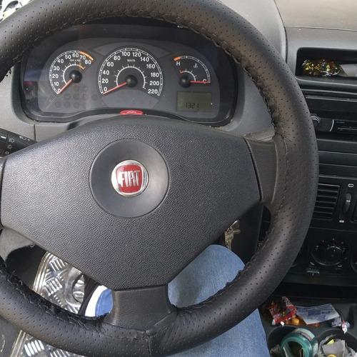 restauração de volantes com capas costuradas a mão