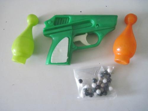 revolver tira bolos con  bolillas  retro 1980