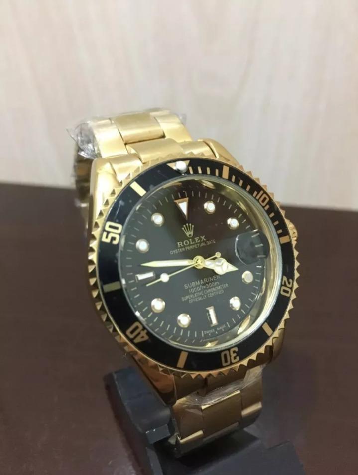 25ce3ef46b4 rolex submariner dourado fundo preto oyster perpetual top. Carregando zoom.