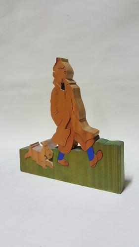 rompecabezas antiguo en madera de tin tin y de perro