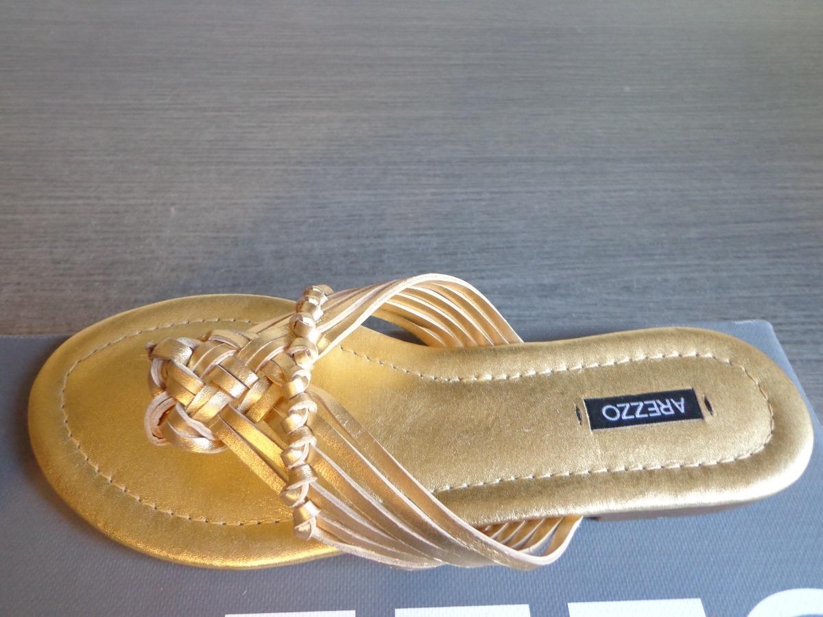 574a04d3c1 sandália rasteira arezzo original rasteirinha dourada. Carregando zoom.